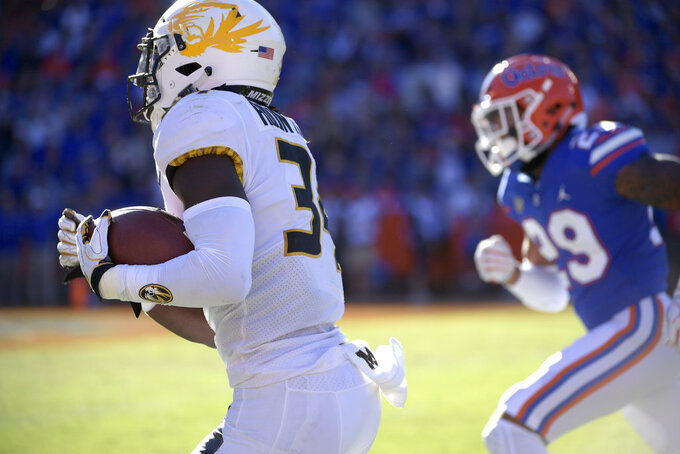 Missouri running back Larry Rountree III (34) runs down the sideline past Florida defensive back Jeawon Taylor (29) for a 27-yard rushing touchdown during the first half of an NCAA college football game Saturday, Nov. 3, 2018, in Gainesville, Fla. (AP Photo/Phelan M. Ebenhack)