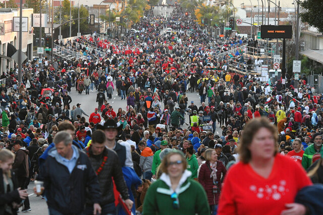 FILE - In this Jan. 1, 2020, file photo, crowds line the parade route on Colorado Boulevard before the start of the 131st Rose Parade in Pasadena, Calif. Organizers have canceled the 2021 Rose Parade because of the impact of the coronavirus pandemic on long-range planning for the New Year's tradition. The Pasadena, California, Tournament of Roses Association said Wednesday, July 15, 2020, that the decision was put off until organizers were certain that safety restrictions would prevent staging of the 132nd parade. (AP Photo/Michael Owen Baker, File)