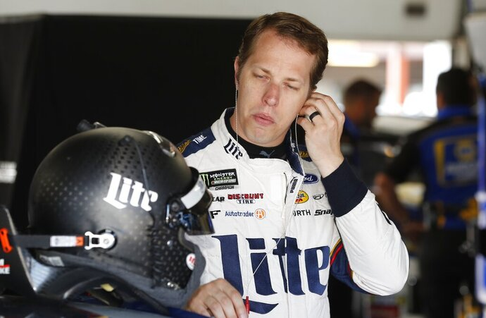 Brad Keselowski prepares for practice for a NASCAR cup series auto race at Michigan International Speedway, Friday, June 7, 2019, in Brooklyn, Mich. (AP Photo/Carlos Osorio)