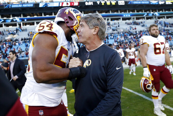 Washington Redskins linebacker Myles Humphrey (54) hugs head coach Bill Callahan following an NFL football game against the Carolina Panthers in Charlotte, N.C., Sunday, Dec. 1, 2019. (AP Photo/Brian Blanco)