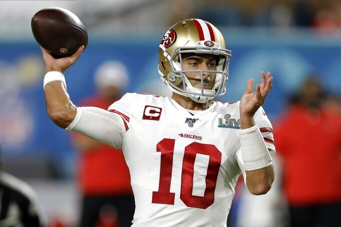 San Francisco 49ers quarterback Jimmy Garoppolo passes against the Kansas City Chiefs during the first half of the NFL Super Bowl 54 football game Sunday, Feb. 2, 2020, in Miami Gardens, Fla. (AP Photo/Chris O'Meara)