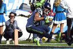 Seattle Seahawks wide receiver Tyler Lockett (16) scores a touchdown against the Carolina Panthers during the first half of an NFL football game in Charlotte, N.C., Sunday, Dec. 15, 2019. (AP Photo/Mike McCarn)
