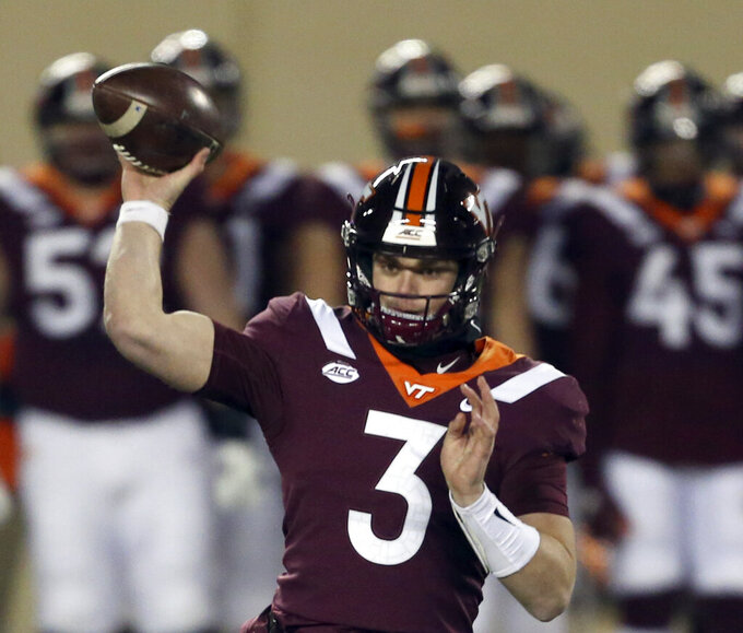 Virginia Tech quarterback Braxton Burmeister throws a pass during the first half against Clemson in an NCAA college football game Saturday, Dec. 5, 2020, in Blacksburg, Va. (Matt Gentry/The Roanoke Times via AP, Pool)