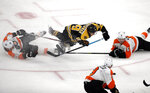 Boston Bruins right wing David Pastrnak (88) goes down as he chases the puck against Philadelphia Flyers center Claude Giroux (28) and defenseman Travis Sanheim (6) in the third period of an NHL hockey game, Thursday, Jan. 31, 2019, in Boston. (AP Photo/Elise Amendola)