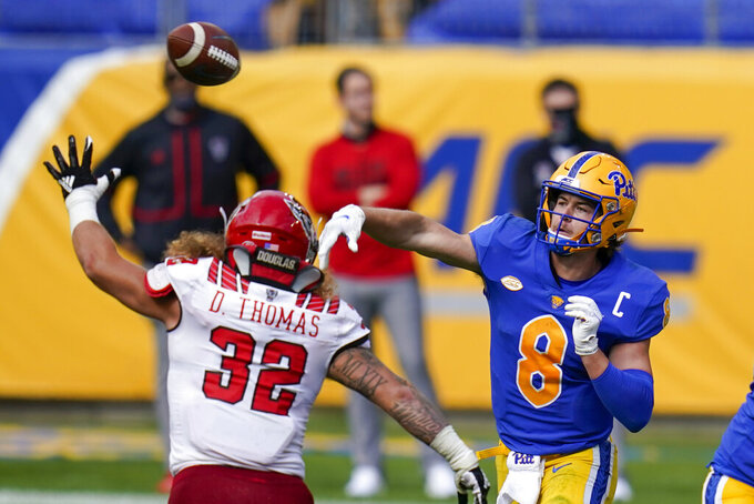 Pittsburgh Panthers quarterback Kenny Pickett (8) passes over North Carolina State linebacker Drake Thomas (32) during the second half of an NCAA college football game, Saturday, Oct. 3, 2020, in Pittsburgh. North Carolina State won 30-29. (AP Photo/Keith Srakocic)