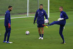 U.S. Men's National Team goalkeepers Matt Turner, left, and Ethan Horvath, right, warm up during soccer practice Tuesday, Aug. 31, 2021, in Nashville, Tenn. (AP Photo/Mark Humphrey)