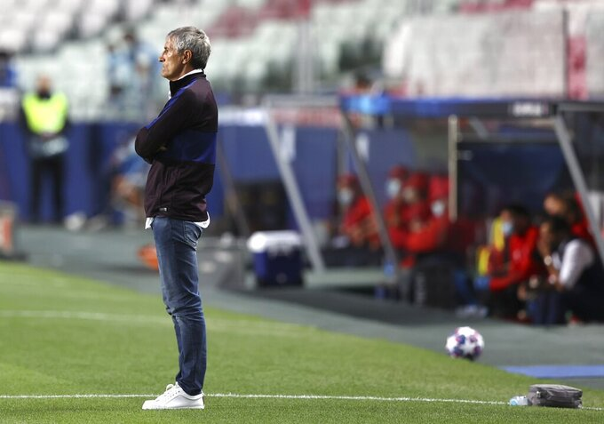 Barcelona's head coach Quique Setien watches from the sideline during the Champions League quarterfinal soccer match between Barcelona and Bayern Munich in Lisbon, Portugal, Friday, Aug. 14, 2020. (Rafael Marchante/Pool via AP)