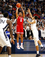 Wisconsin's D'Mitrik Trice (0) puts up a three-point shot over Penn State's Rasir Bolton (13) during first half action of an NCAA college basketball game in State College, Pa. Sunday, Jan. 6, 2019. (AP Photo/Chris Knight)