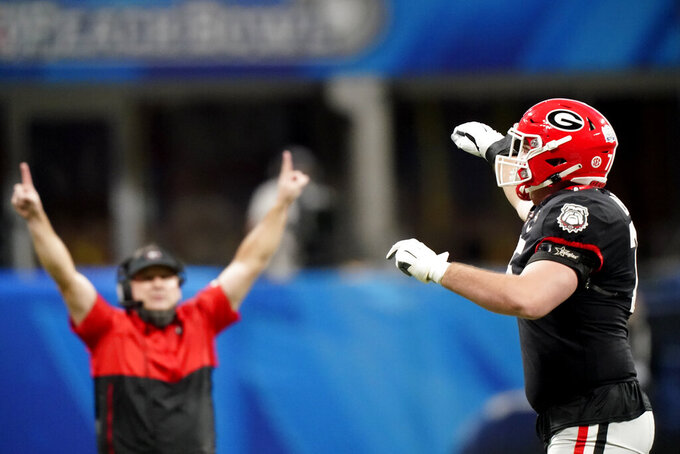 Georgia offensive lineman Owen Condon (75) celebrates a Georgia field goal against Cincinnati during the second half of the Peach Bowl NCAA college football game, Friday, Jan. 1, 2021, in Atlanta. Georgia won 22-21. (AP Photo/Brynn Anderson)