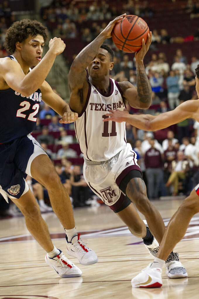 Texas A&M guard Wendell Mitchell (11) drives the lane against Gonzaga forward Anton Watson (22) during the second half of an NCAA college basketball game Friday, Nov. 15, 2019, in College Station, Texas. (AP Photo/Sam Craft)