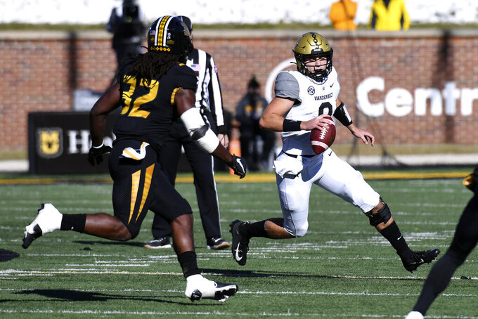Vanderbilt quarterback Ken Seals scrambles as Missouri linebacker Nick Bolton (32) defends during the first half of an NCAA college football game Saturday, Nov. 28, 2020, in Columbia, Mo. (AP Photo/L.G. Patterson)