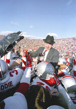FILE - In this Nov. 21, 1987, file photo, Ohio State football coach Earle Bruce is carried by his players after the Buckeyes beat Michigan 23-20 in Ann Arbor, Mich. Bruce died in Columbus, Ohio at the age of 87, according to a statement released by his daughters through Ohio State on Friday. He'd been suffering from Alzheimer's disease.  (AP Photo/Robert Kozloff, File)