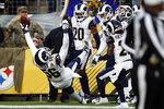 Los Angeles Rams defensive end Dante Fowler (56) celebrates his touchdown on a fumble recovery during the first half of an NFL football game against the Pittsburgh Steelers in Pittsburgh, Sunday, Nov. 10, 2019. (AP Photo/Keith Srakocic)