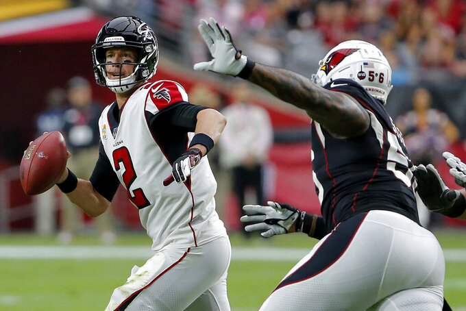 Atlanta Falcons quarterback Matt Ryan (2) scrambles as Arizona Cardinals outside linebacker Terrell Suggs pursues during the second half of an NFL football game, Sunday, Oct. 13, 2019, in Glendale, Ariz. (AP Photo/Rick Scuteri)