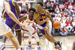 LSU guard Javonte Smart (1) works inside around Alabama guard Kira Lewis Jr. (2) during the first half of an NCAA college basketball game, Saturday, Feb. 15, 2020, in Tuscaloosa, Ala. (AP Photo/Vasha Hunt)