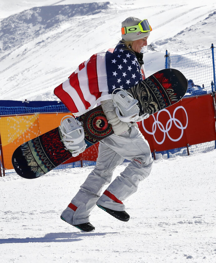 Jamie Anderson, of the United States, celebrates winning gold after the women's slopestyle final at Phoenix Snow Park at the 2018 Winter Olympics in Pyeongchang, South Korea, Monday, Feb. 12, 2018. (AP Photo/Lee Jin-man)