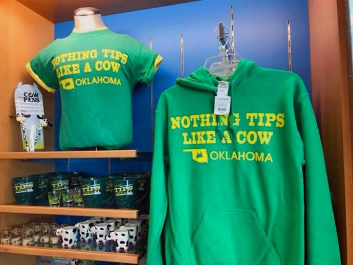 This undated photo provided by Will Rogers World Airport shows T-shirts for sale at the airport in Oklahoma City, Okla. Oklahoma City Mayor David Holt said on his Twitter account Thursday, Feb. 21, that after months of trying to end sales of the shirts reading