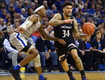 Cincinnati guard Jarron Cumberland (34) handles the ball against Memphis forward Kyvon Davenport (0) in the first half of an NCAA college basketball game Thursday, Feb. 7, 2019, in Memphis, Tenn. (AP Photo/Brandon Dill)