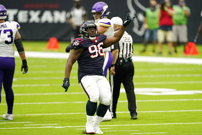 Houston Texans defensive end P.J. Hall (96) celebrates after makes a play against the Minnesota Vikings during the second half of an NFL football game Sunday, Oct. 4, 2020, in Houston. (AP Photo/David J. Phillip)