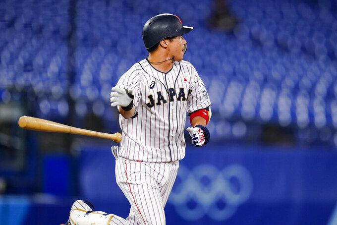 Japan's Tetsuto Yamada tosses his bat after hitting a three run double in the eight inning of a semi-final baseball game against South Korea at the 2020 Summer Olympics, Wednesday, Aug. 4, 2021, in Yokohama, Japan. (AP Photo/Matt Slocum)
