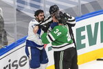 Dallas Stars right wing Denis Gurianov (34) and Tampa Bay Lightning center Cedric Paquette (13) scuffle during the first period of Game 3 of the NHL hockey Stanley Cup Final, Wednesday, Sept. 23, 2020, in Edmonton, Alberta. (Jason Franson/The Canadian Press via AP)