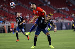 Chile's Paulo Diaz, top, defends against Argentina's Lautaro Martinez during the first half of an international friendly soccer match Thursday, Sept. 5, 2019, in Los Angeles. (AP Photo/Marcio Jose Sanchez)