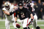 Atlanta Falcons quarterback Matt Ryan (2) runs out of the pocket against the New Orleans Saints during the first half of an NFL football game, Thursday, Nov. 28, 2019, in Atlanta. (AP Photo/John Bazemore)