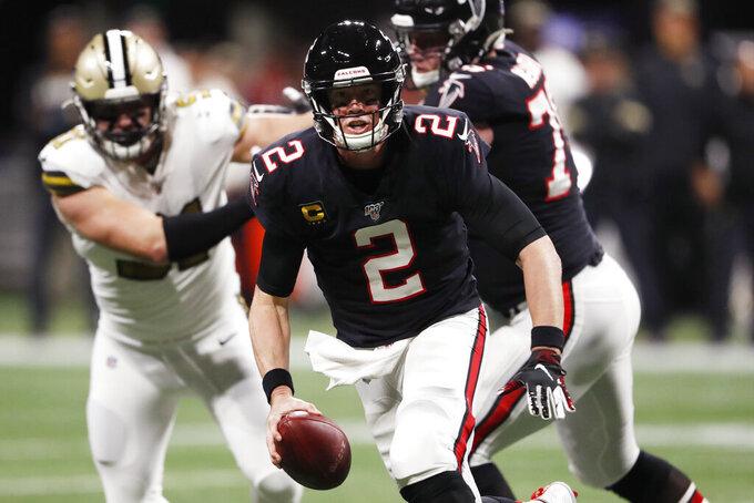 Atlanta Falcons quarterback Matt Ryan (2) runs out of the pocket against the New Orleans Saints during the first half of an NFL football game, Thursday, Nov. 28, 2019, in Atlanta. (AP Photo/John Bazemore)