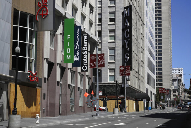 FILE - In this May 27, 2020, file photo, closed businesses are seen in downtown San Francisco. A California judge has ordered changes to an election information guide for arguments opposing a property tax ballot initiative. Proposition 15 will ask voters to raise taxes on business properties with a value of $3 million or more. (AP Photo/Ben Margot, File)