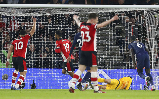 Southampton's Sofiane Boufal turns to celebrate after scoring his side's first goal of the game during the FA Cup fourth round soccer match between Southampton and Tottenham Hotspur at St Mary's Stadium, Southampton, England. Saturday, Jan. 25, 2020. (Steven Paston/PA via AP)