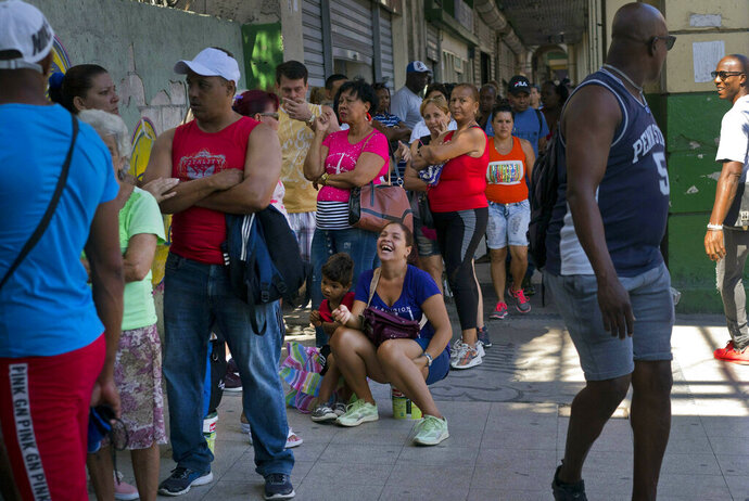 FILE - In this April 17, 2019 file photo, people wait in line to buy chicken at a government-run grocery store in Havana, Cuba. The Cuban government said Friday, May 10, that it will begin widespread rationing of chicken, eggs, rice, beans, soap and other basic products in the face of a grave economic crisis. (AP Photo/Ramon Espinosa, File)