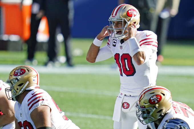 San Francisco 49ers quarterback Jimmy Garoppolo calls to his team during the first half of an NFL football game against the Seattle Seahawks, Sunday, Nov. 1, 2020, in Seattle. (AP Photo/Elaine Thompson)