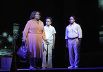 """This Sept. 17, 2021 image released by the Metropolitan Opera shows, from left, Latonia Moore as Billie, Walter Russell III as Char'es-Baby and Will Liverman as Charles during a rehearsal for Terence Blanchard's """"Fire Shut Up in My Bones,"""" opening the Metropolitan Opera season on Sept. 27. (Ken Howard/Met Opera via AP)"""