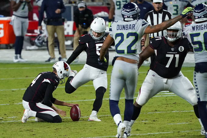 Arizona Cardinals kicker Zane Gonzalez (5) kicks a game-tying field goal as punter Andy Lee (4) holds during the second half of an NFL football game against the Seattle Seahawks, Sunday, Oct. 25, 2020, in Glendale, Ariz. (AP Photo/Ross D. Franklin)