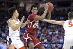 Oklahoma guard Jamal Bieniemy (24) is defended by Virginia guard Kihei Clark (0) and Kyle Guy (5) during the first half of a second-round game in the NCAA men's college basketball tournament Sunday, March 24, 2019, in Columbia, S.C. (AP Photo/Sean Rayford)
