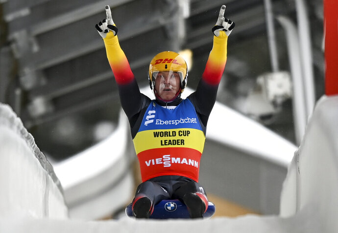 Felix Loch from Germany is happy about his victory at the Luge World Cup in Oberhof, Germany, Saturday, Jan. 16, 2021. (Hendrik Schmidt/dpa via AP)