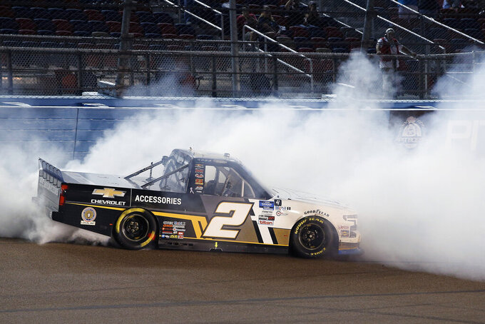 Sheldon Creed does a burnout after winning the NASCAR Truck Series auto race at Phoenix Raceway, Friday, Nov. 6, 2020, in Avondale, Ariz. Creed also won the season championship. (AP Photo/Ralph Freso)