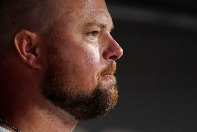 St. Louis Cardinals starting pitcher Jon Lester stands in the dugout during the eighth inning of a baseball game against the Cincinnati Reds Friday, Sept. 10, 2021, in St. Louis. (AP Photo/Jeff Roberson)