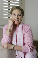 """FILE - This May 5, 2007 file photo shows actress and singer Julie Andrews poses in Los Angeles. Andrews released a memoir, """"Home Work: A Memoir of My Hollywood Years,"""" which hits shelves on Oct. 15, 2019. (AP Photo/Chris Carlson, File)"""