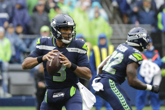 Seattle Seahawks quarterback Russell Wilson readies a pass against the New Orleans Saints during the first half of an NFL football game Sunday, Sept. 22, 2019, in Seattle. (AP Photo/Ted S. Warren)