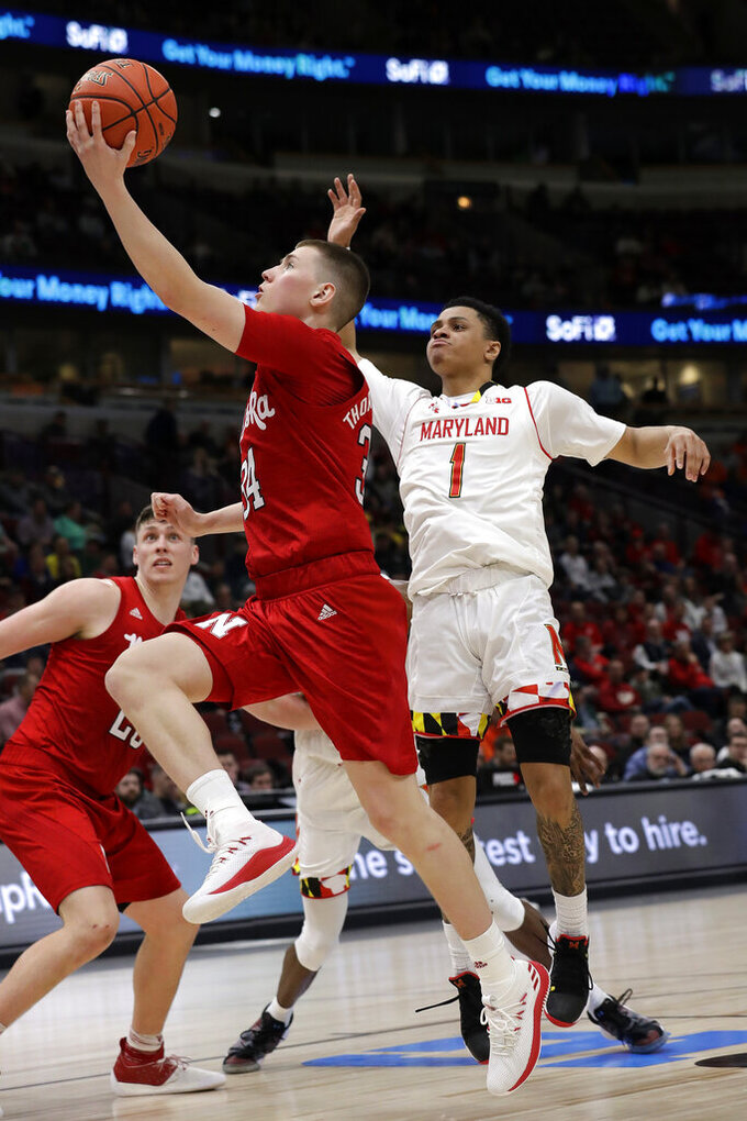 FILE - In this March 14, 2019, file photo, Nebraska's Thorir Thorbjarnarson (34) drives against Maryland's Anthony Cowan Jr. (1) to the basket during the first half of an NCAA college basketball game in the second round of the Big Ten Conference tournament, in Chicago. Nebraska fans will need to keep a roster handy when they watch Fred Hoiberg's first Cornhuskers team. Of the 16 players, 14 weren't on the team in 2018-19. Thorbjarnarson is the only one of the two returning players has suited up for a game with the Cornhuskers.  (AP Photo/Nam Y. Huh, File)