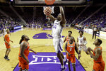 Makol Mawien (14) dunks during the second half of an NCAA college basketball game against Florida A&M, Monday, Dec. 2, 2019, in Manhattan, Kan. (AP Photo/Charlie Riedel)