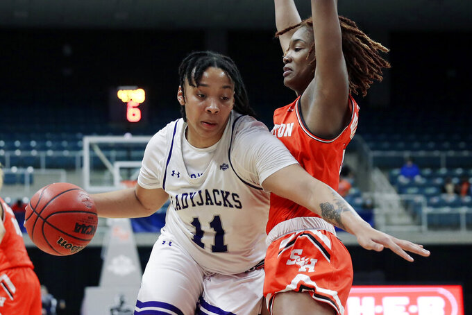 Stephen F. Austin forward Avery Brittingham (11) drives around Sam Houston State forward Courtney Cleveland, right, during the second half of an NCAA college basketball game for the Southland Conference women's tournament championship Sunday, March 14, 2021, in Katy, Texas. (AP Photo/Michael Wyke)
