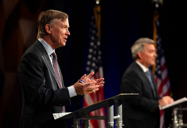 Democratic challenger John Hickenlooper, front, talks during a debate with Republican U.S. Senator Cory Gardner during a debate between the candidates Tuesday, Oct. 13, 2020, in Fort Collins, Colo. (Pool Photo By Bethany Baker/Fort Collins Coloradoan via AP)