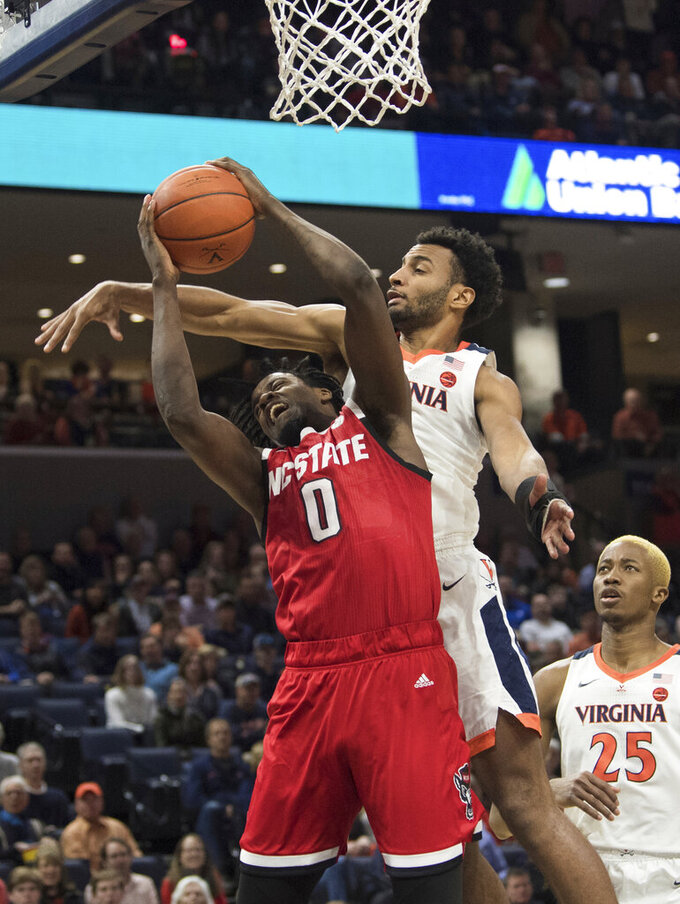 North Carolina State forward D.J. Funderburk (0) gets fouled by Virginia guard Braxton Key (2) during the first half of an NCAA college basketball game in Charlottesville, Va., Monday, Jan. 20, 2020. (AP Photo/Lee Luther Jr.)