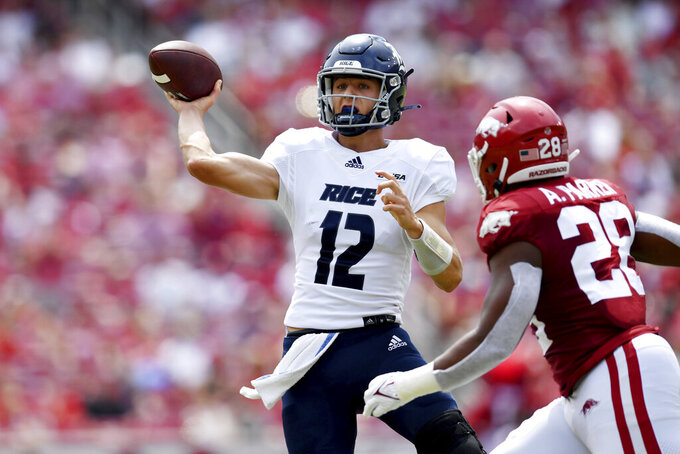 Rice quarterback Luke McCaffrey (12) throws a pass against Arkansas during the first half of an NCAA college football game Saturday, Sept. 4, 2021, in Fayetteville, Ark. (AP Photo/Michael Woods)