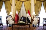 Qatar's Deputy Prime Minister and Foreign Minister Sheikh Mohammed bin Abdulrahman bin Jassim Al-Thani, left, meets with Egyptian Foreign Minister Sameh Shoukry, center, at the Tahrir Palace in Cairo, Egypt, Tuesday, May 25, 2021. (AP Photo/Nariman El-Mofty)