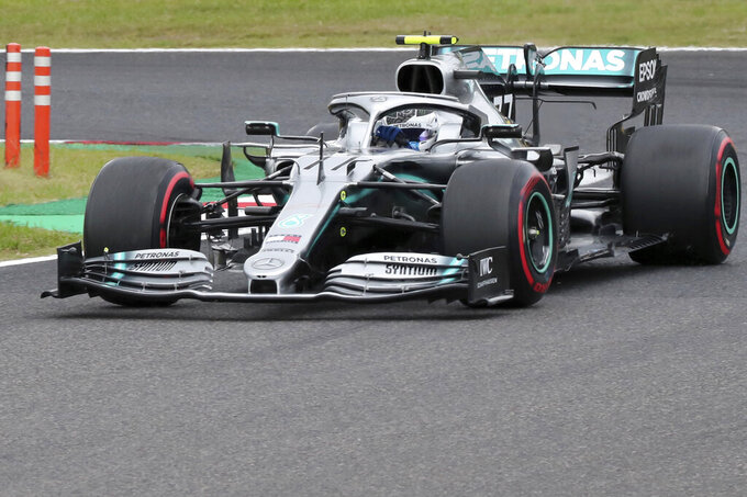 Mercedes driver Valtteri Bottas of Finland steers his car during the second practice session for the Japanese Formula One Grand Prix at Suzuka Circuit in Suzuka, central Japan, Friday, Oct. 11, 2019. (AP Photo/Toru Takahashi)