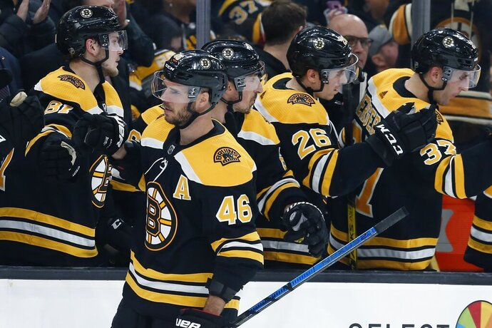 Boston Bruins' David Krejci (46) celebrates his goal during the third period of an NHL hockey game against the Vancouver Canucks in Boston, Tuesday, Feb. 4, 2020. (AP Photo/Michael Dwyer)