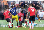 Manchester United's Mason Greenwood, second left, scores his side's first goal of the game against Southampton, during their English Premier League soccer match at St. Mary's Stadium in Southampton, England, Sunday Aug. 22, 2021. (Andrew Matthews/PA via AP)